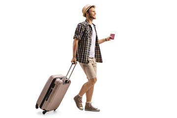 Tourist with a passport and a suitcase walking