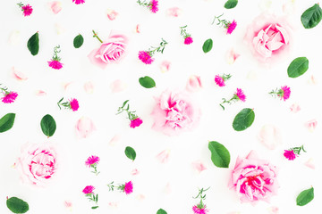 Floral pattern with pink roses, petals and leaves on white background. Flat lay, top view. Valentines day background