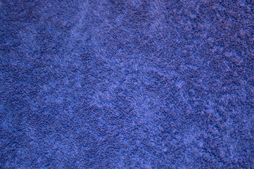 Purple cotton towel texture, fibers of bath towel background