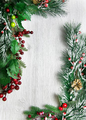 Christmas and New Year's composition. The pine cones, spruce branches on a wooden white background