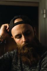 Bearded thoughtful man posing at camera