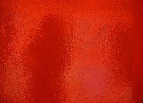 Rote glänzende Folie als Hintergrund