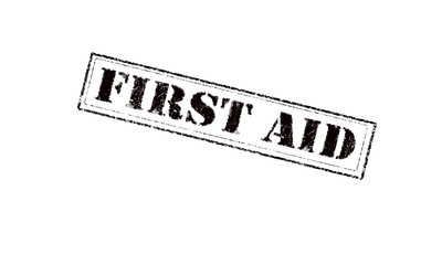 first aid rubber stamp on a white background red letters