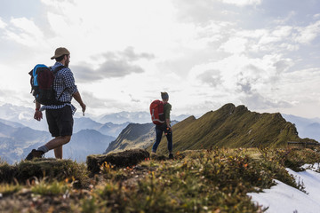 Germany, Bavaria, Oberstdorf, two hikers walking on mountain ridge