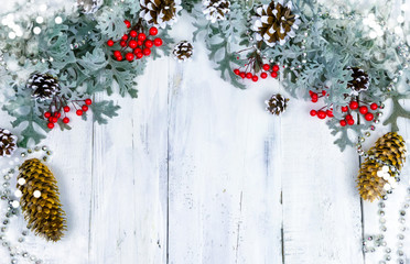 Christmas wooden background with snow branch. Top view with copy space for your text
