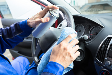 Man Cleaning Car Steering Wheel