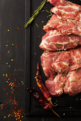Raw pork steak with spices and rosemary