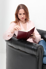 Business sexy woman holding a book and reading