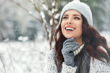 beautiful smiling young woman in wintertime outdoor. Winter concept