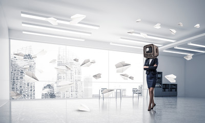 Business woman with an old TV instead of head.