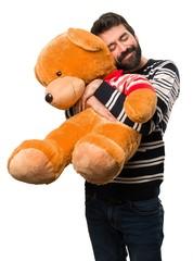 Happy Man with beard playing with stuffed animal