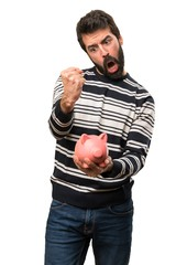 Happy Man with beard holding a piggybank
