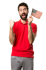 Happy Handsome man holding an american flag