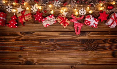 Christmas background with wooden decorations, gifts and spot lights