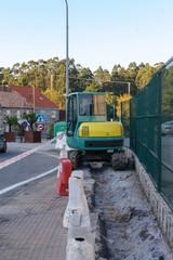 excavator repairs roads