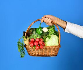 Vegetarian diet concept. Wicker basket with fresh vegetables