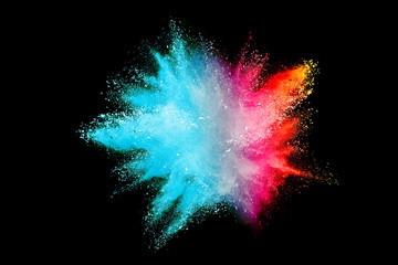 Splash of colorful powder over black background.
