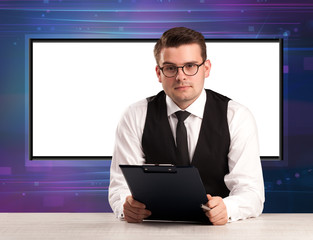 Television program host with big copy screen in his back