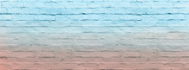 banner brick wall covered with ombre blue and pink lime