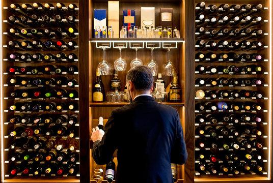 Man chooses a bottle of wine