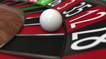 Casino roulette wheel ball hits 12 twelve red. 3D rendering