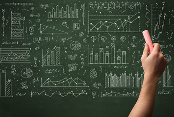 A business person drawing data on chalkboard