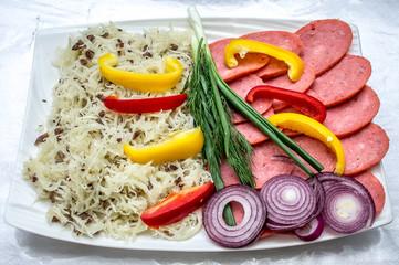 Sausage and vegetables sliced