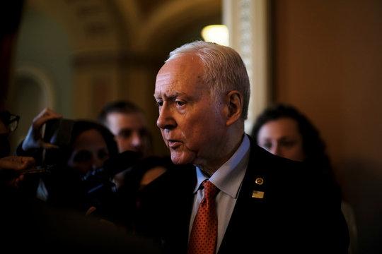 U.S. Senator Orrin Hatch (R-UT) speaks to reporters after leaving the Senate floor during debate over the Republican tax reform plan in Washington