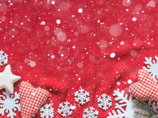 Two soft hearts and white snowflakes on a red background. Christmas background. Valentine's day background. Free space for text. Top view