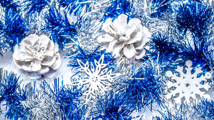 Christmas tinsel and snowflakes as a background