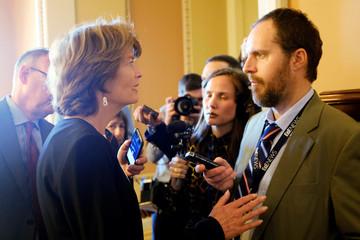U.S. Senator Lisa Murkowski (R-AK) speaks to reporters outside the Senate chamber during debate over the Republican tax reform plan in Washington