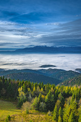 Misty sunrise landscape from Luban peak in Gorce mountains, Poland