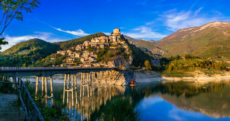 Travel in Italy - beautiful medieval village Castel di Tora and scenic Turano lake. Wall mural