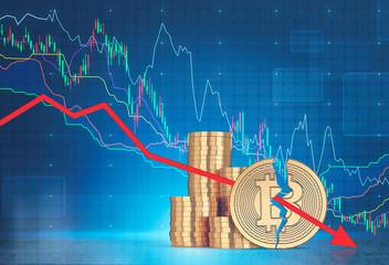Stacks of bitcoins, falling graph close up