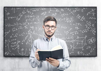 Intelligent young man with a planner, science