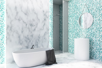 Marble and green tile bathroom corner