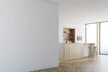 White kitchen, wooden bar stand, wall