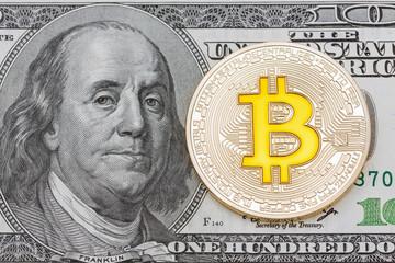 Golden Bitcoins on US dollars. Electronic money exchange concept.