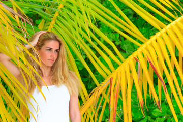 Blonde beauty woman at the beach on Maldives