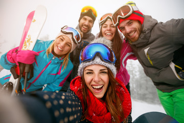 friends making selfie and having fun on winter hodays