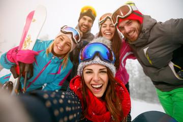 friends making selfie and having fun on winter hodays