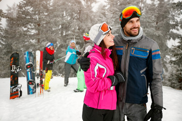 couple snowboarder enjoying at ski resort in the mountain with friends