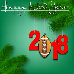 Football ball and 2018 on a Christmas tree branch