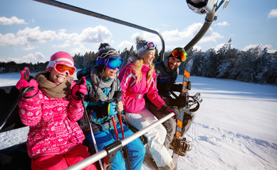 Skiing, ski lift, winter - skiers on ski lift at mountain