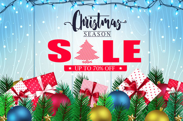 Christmas Season Sale Banner in Blue Wooden Background with Falling Snow, Christmas Lights, Gifts, Balls, Stars and Pine Leaves Promotional Design for Holiday. Vector Illustration