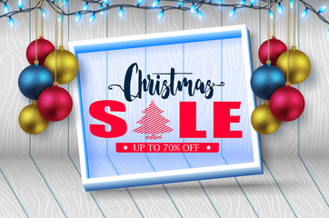 3D Frame Christmas Sale Banner in Wooden Background with Christmas Balls and Lights Holiday Promotional Design. Vector Illustration