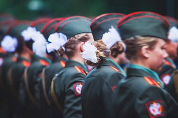 A formation line of female military students with in green uniform, line up during the taking the oath of allegiance ceremony