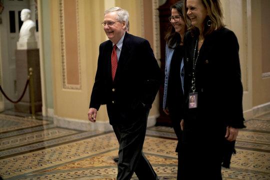 U.S. Senate Majority Leader McConnell walks to the Senate floor as debate wraps up over the Republican tax reform plan in Washington