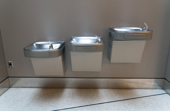 Free drinking water or drinking fountain for traveler in the international airport. Public drinking water concept.
