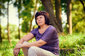 middle-aged brunette in the park